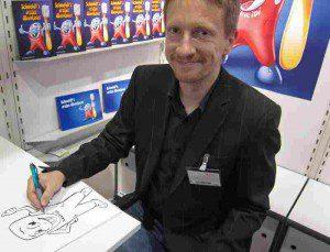 Der Illustrator Carsten Mell mit Schneidi