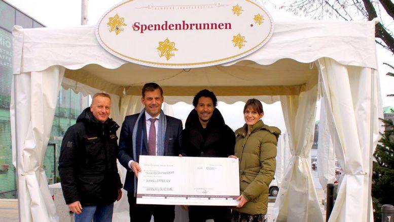 Übergabe Spendenscheck Weißerzauber Jungfernstieg an Dunkelziffer e.V.
