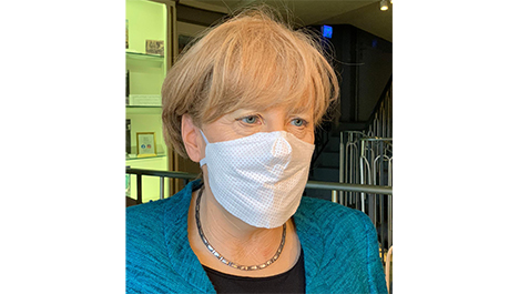 Angela Merkel als Wachsfigur mit Atemmaske im Panoptikum Hamburg