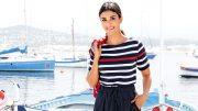 Frau im Bootshafen