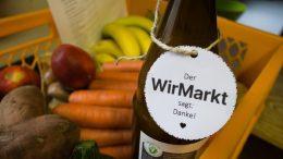WirMarkt Logo an einer Flasche