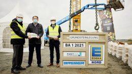Grundsteinlegung bei der Edeka Nord in Neumünster für den 1. Bauschnitt mit Coronamasken