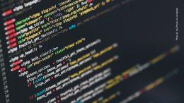Blockchain Symbolbild Programm Code
