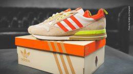 Adidas Schuh auf einem Karton