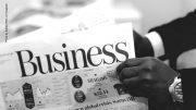 Zeitung mit der Headline Business